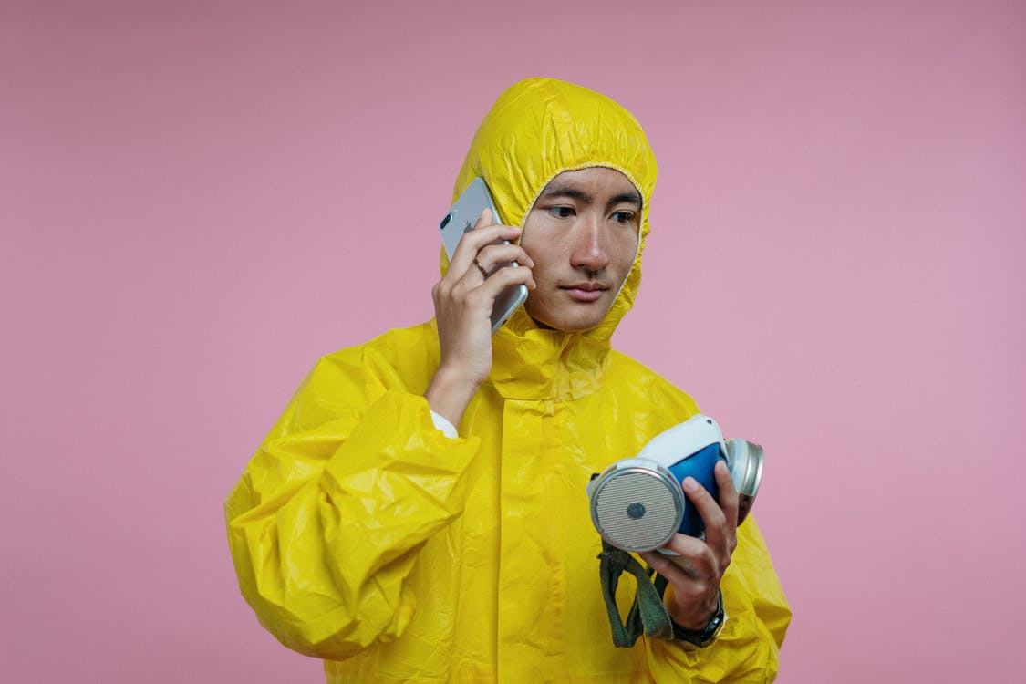 Man in Coveralls Talking on Phone