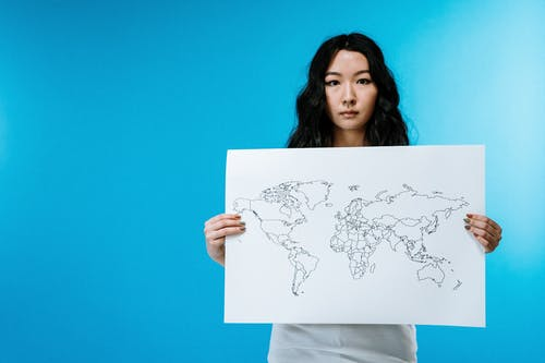 Woman Holding World Map