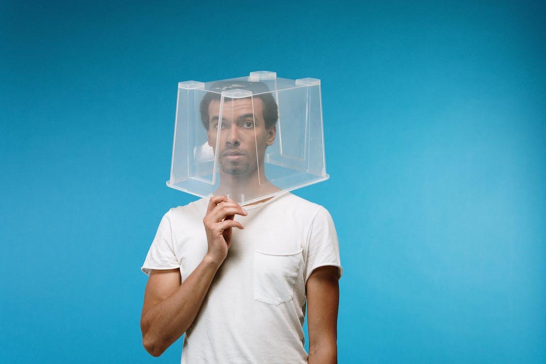 Man Wearing Plastic Box on Head