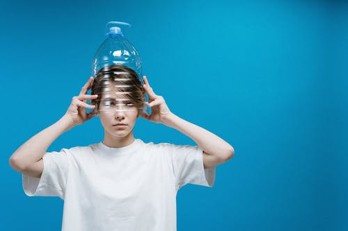 Woman Wearing Plastic Bottle on Head