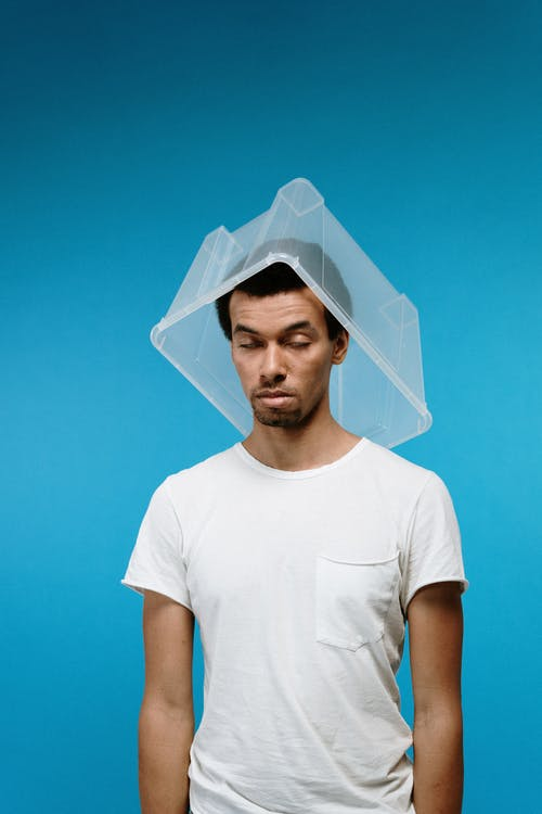 Man Wearing Plastic Box on Head