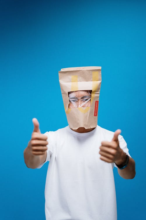 Person Wearing A Paper bag On Head As An Alternative To Mask