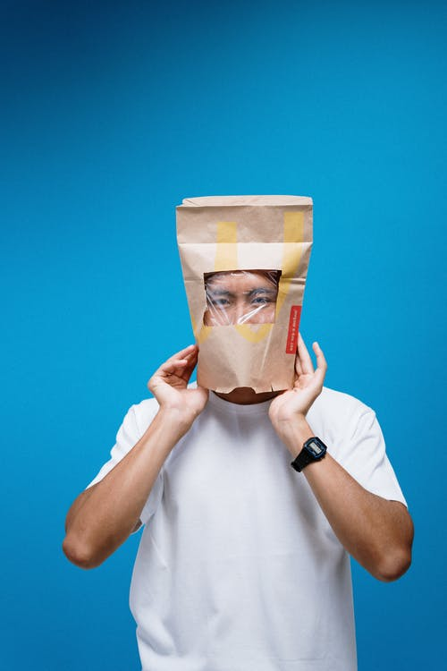 Man Wearing Paper Bag on Head