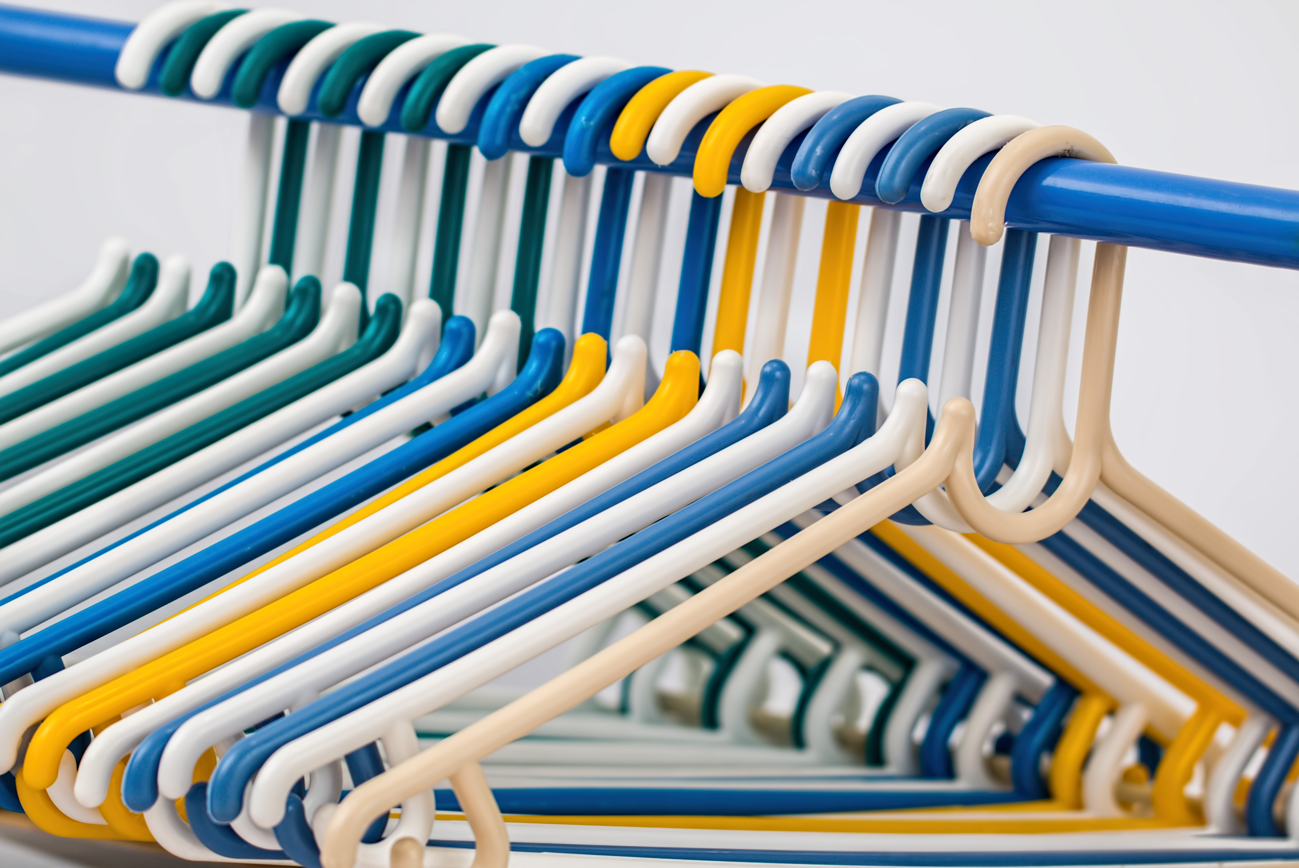 White Blue Yellow and Green Plastic Clothes Hanger · Free Stock Photo