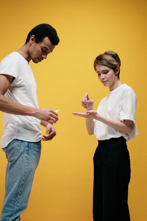Man in White Shirt and Woman in White T-shirt