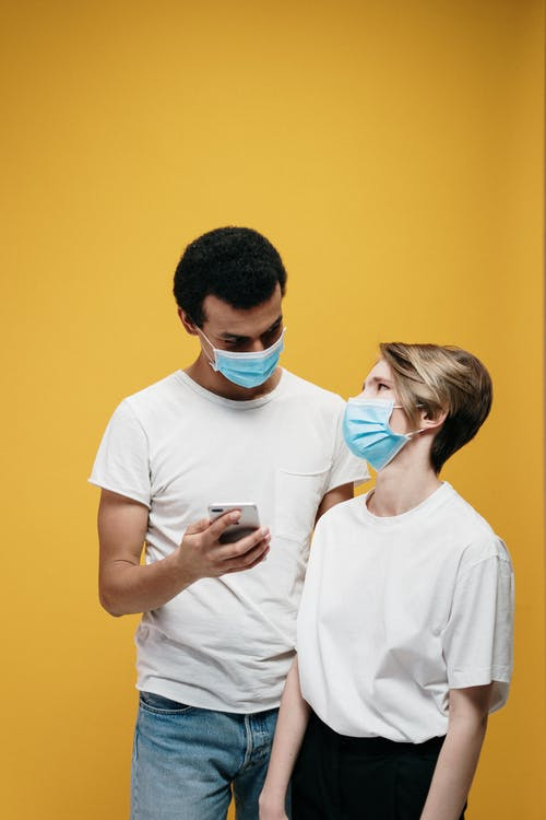 Man and Woman Wearing White T-shirt and Face Mask
