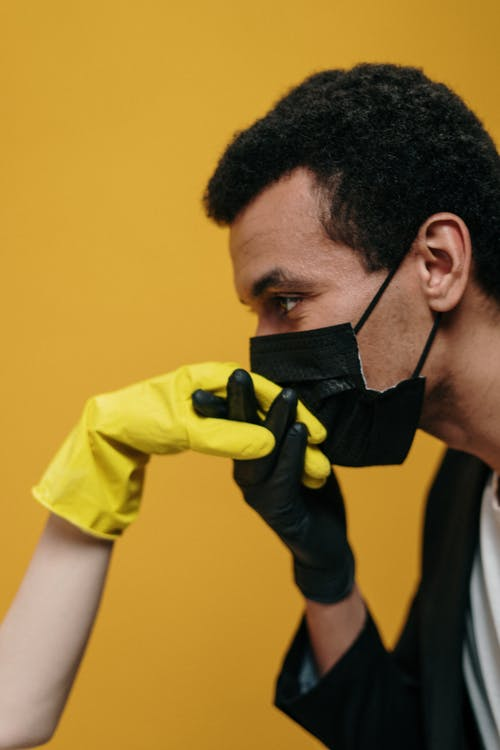 Man in Face Mask Kissing Hand