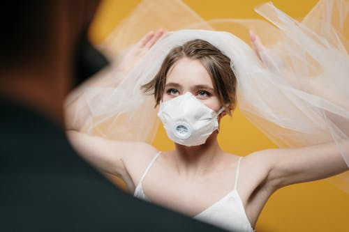 Woman in White Dress Wearing White Face Mask