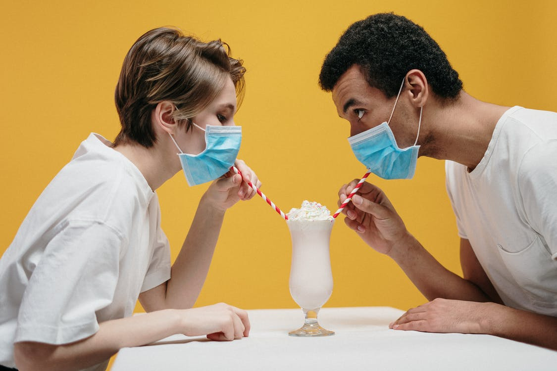 Couple Wearing Face Mask Drinking Milkshake