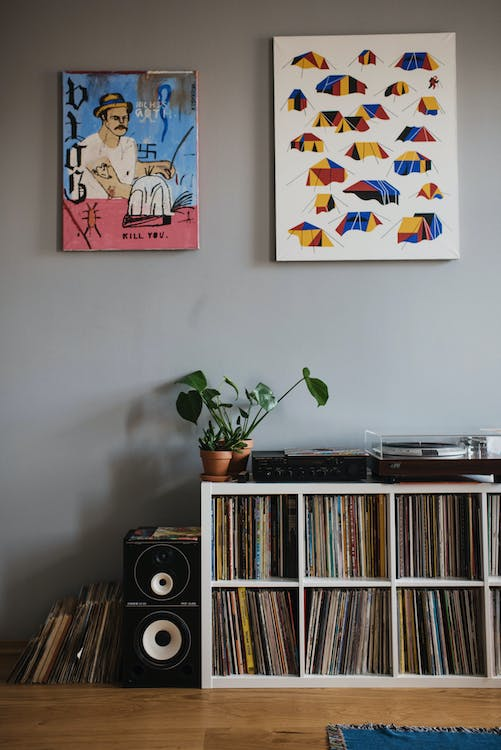 Collection of vinyl records on shelf in apartment