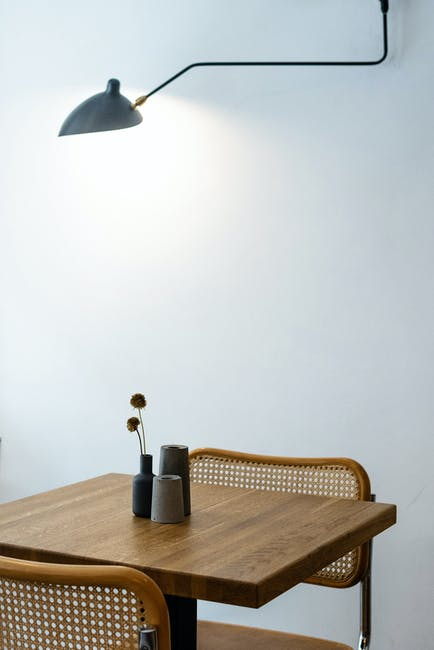 Minimalist interior style with wooden table and chairs at home