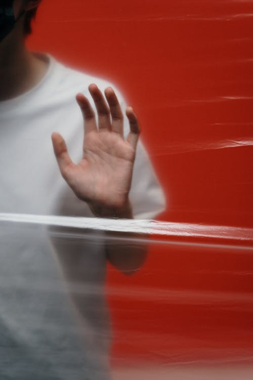 Man in White Crew Neck Shirt With A Stop Hand Gesture
