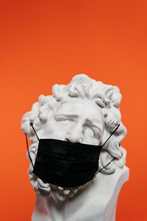 White Concrete Sculpture With Face Mask