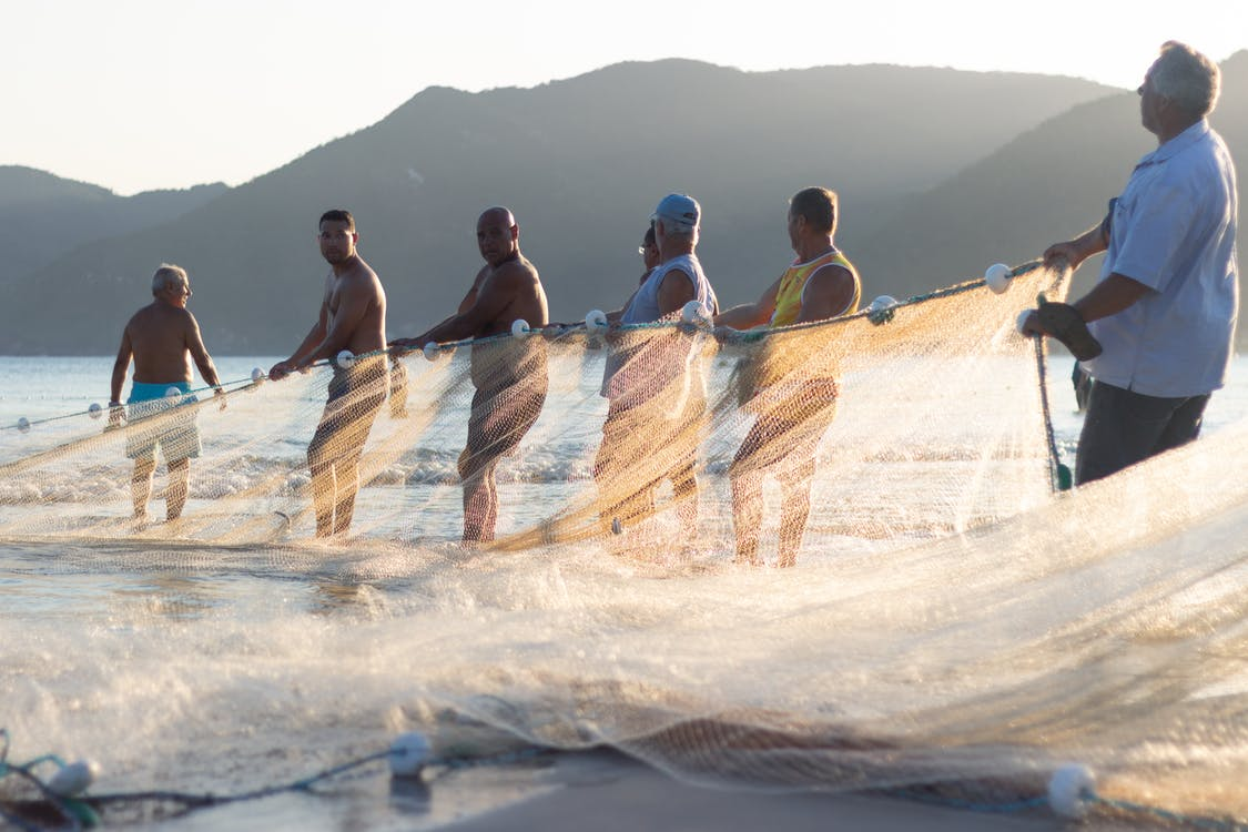 Men Holding A Fishing Net