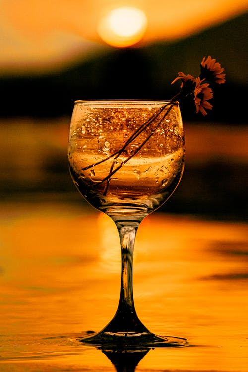 Clear Wine Glass With Brown Liquid