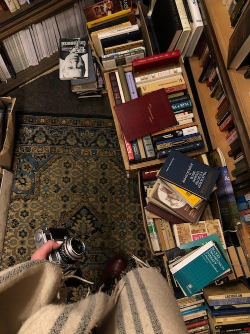 Books on Brown Wooden Shelves