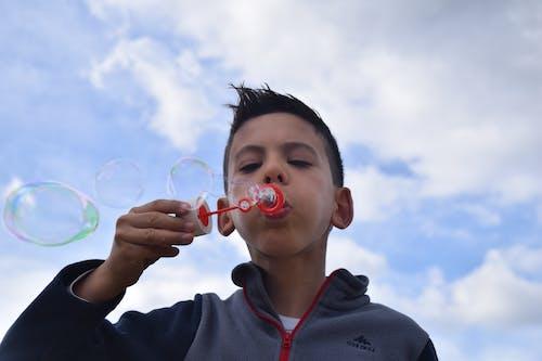 Free stock photo of boy, bubbles, fun, kid