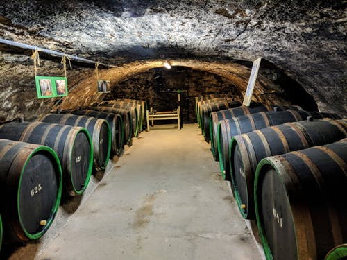 Brown Wooden Barrels In A Wine Cellar