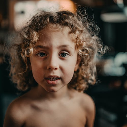 Shirtless Child With Curly Hair