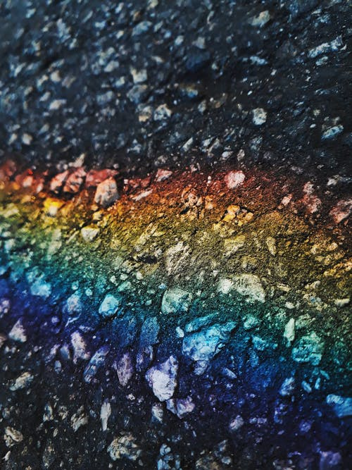 Abstract background with rainbow colors on rough icy surface