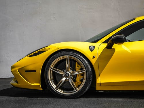 Yellow Ferrari 458 Italia Parked Near White Wall