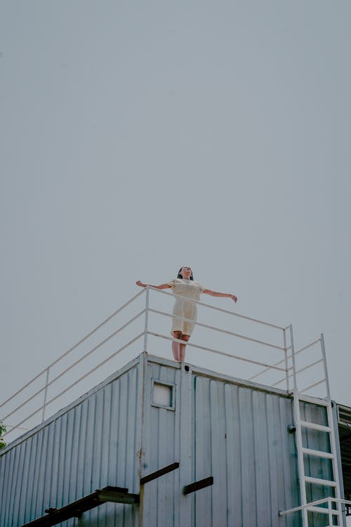 Person Standing On Roof