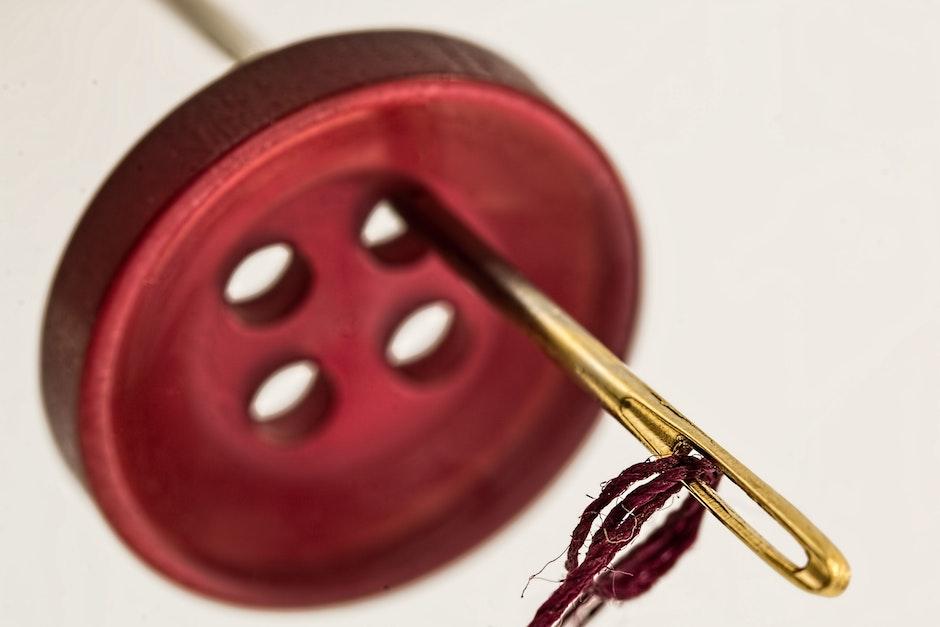 Brass Needle Through Red Cloth Button