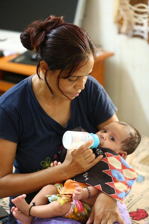 Woman Feeding Her Baby