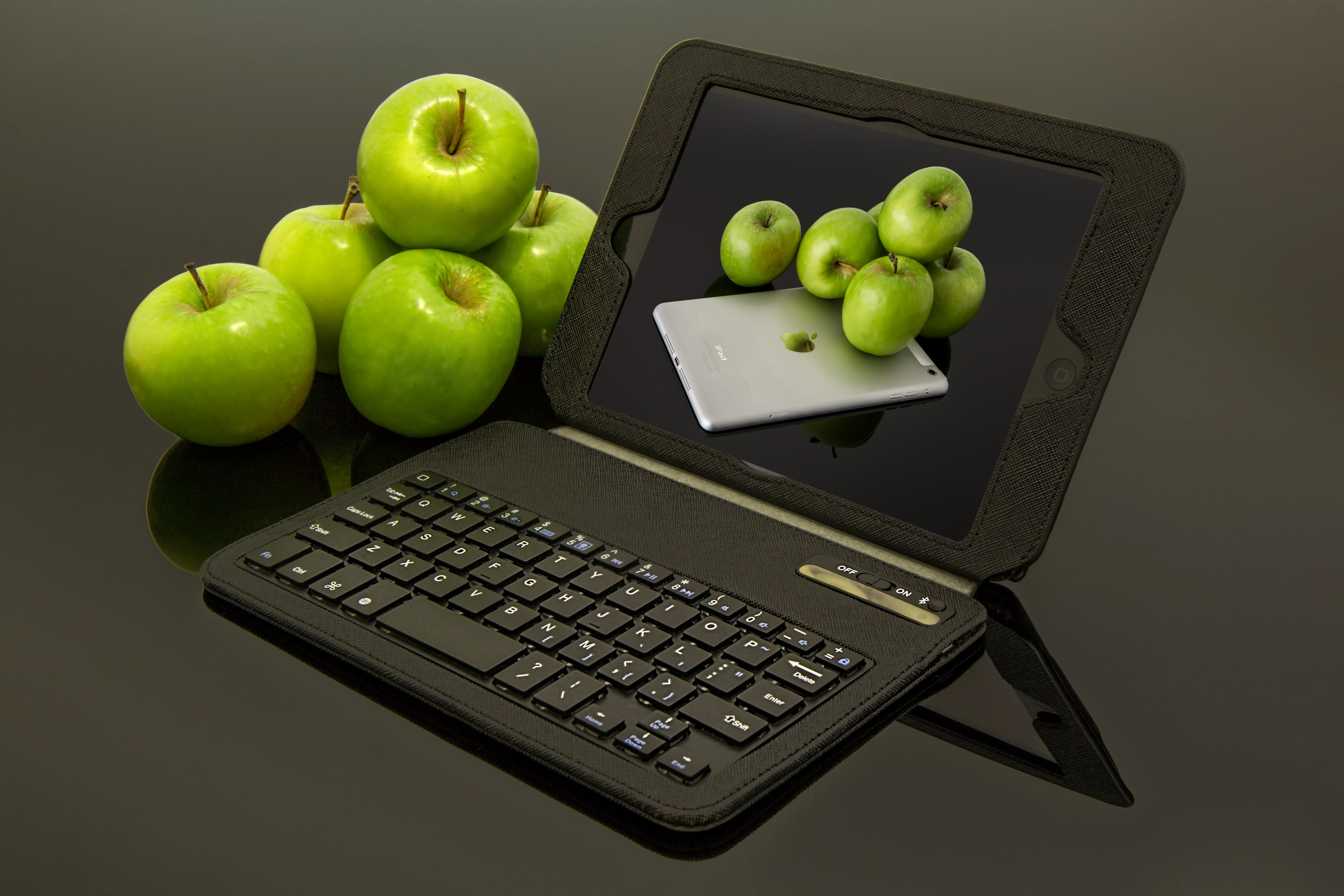 Black Laptop Computer Beside Green Apples