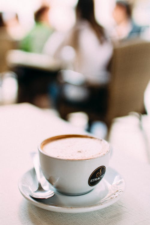 Selective Focus Photography of Cup of Coffee