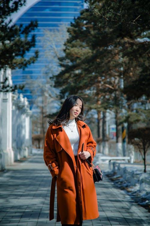 Woman in Brown Coat Standing on Sidewalk