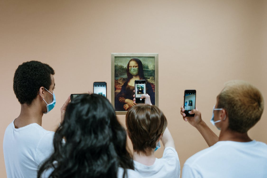 People Taking Picture of A Painting Of Mona LIsa With Face Mask