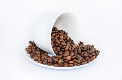 Coffee Beans on White Ceramic Saucer