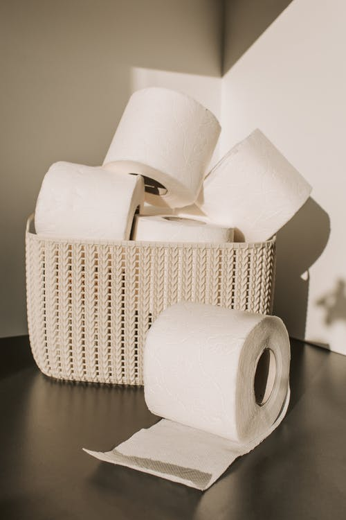 White Toilet Paper Roll on Woven Basket