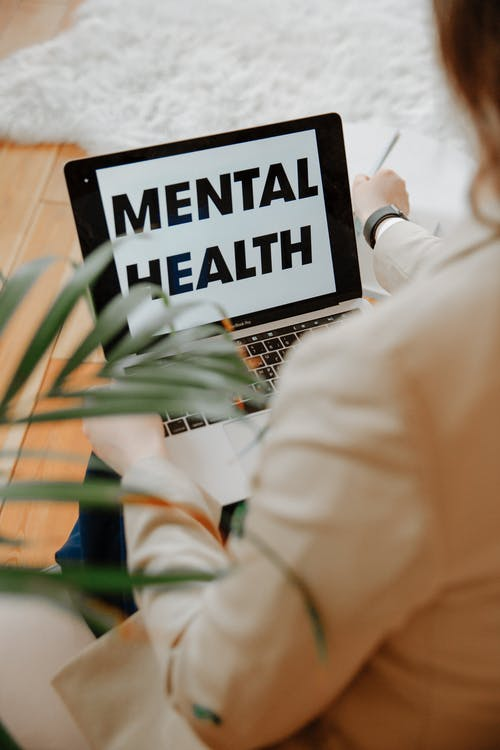 The Words Mental Health on Laptop Screen