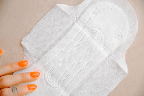 Woman Touching Sanitary Pad