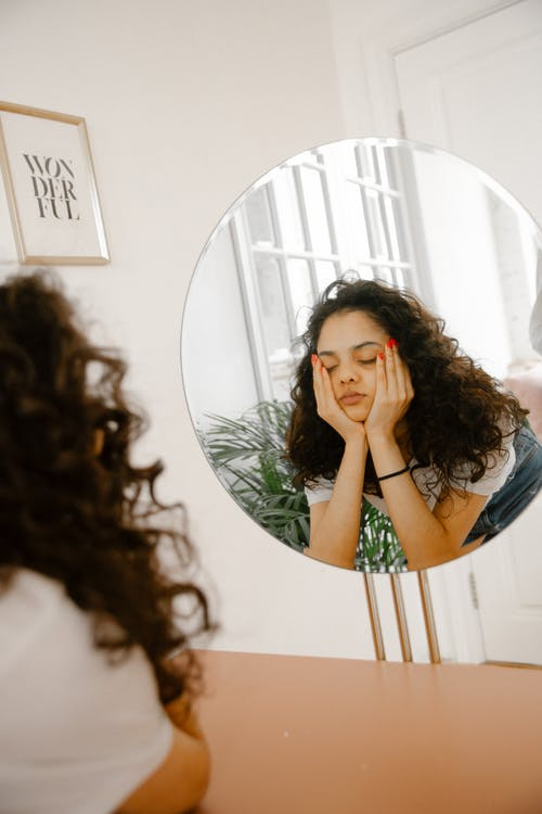 Reflection of Young Woman in Mirror