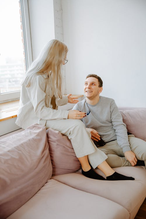 Couple Talking on Couch