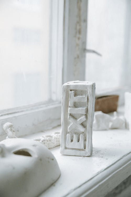 Exit Carving on White Block