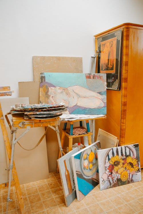 Old aged artist workshop with creative paintings