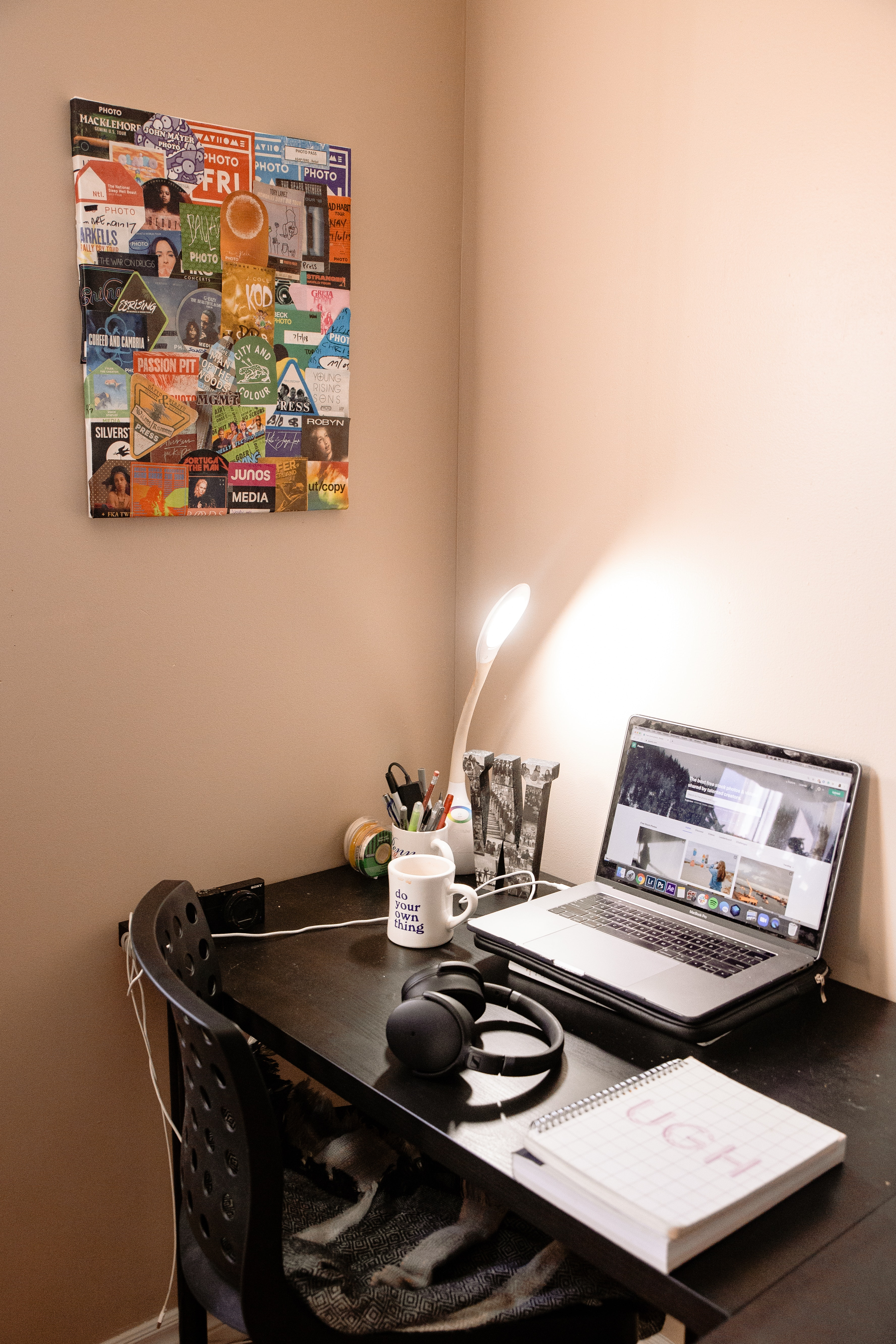 Macbook Pro On Table Beside Wall Free Stock Photo