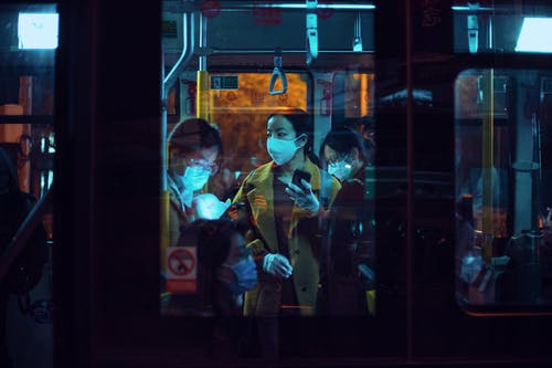 People Inside A Bus Wearing Masks