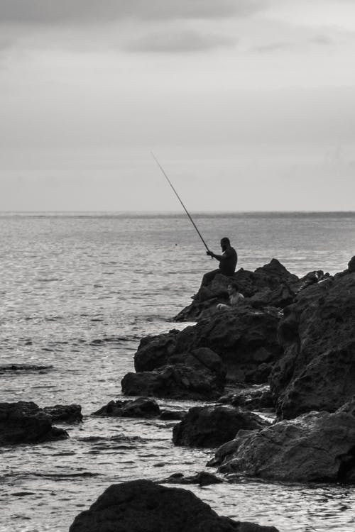 Man Fishing On  Sea