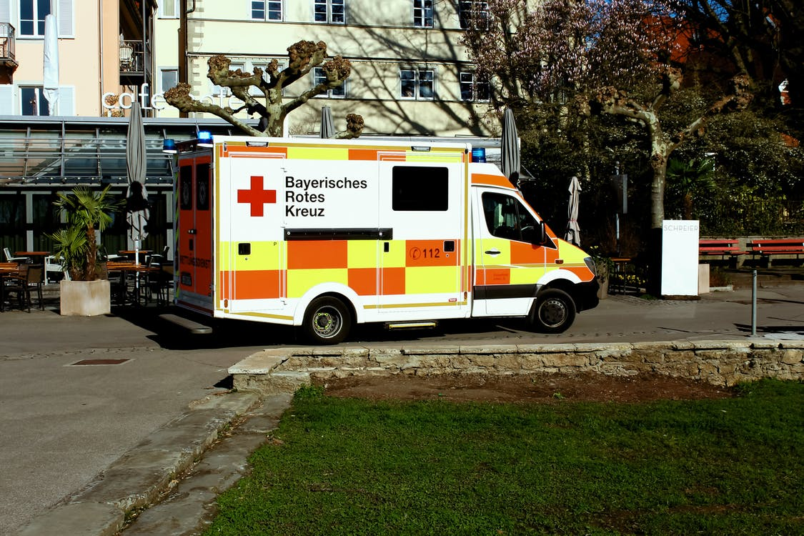 Ambulance Truck Parked Near Building