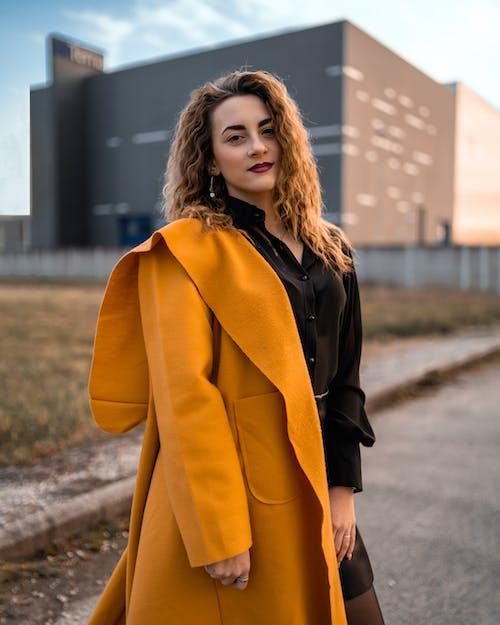 Woman In Black Top Wearing A Coat