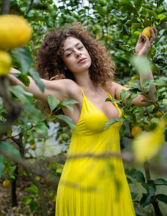 Woman Standing Near Lemon Plants