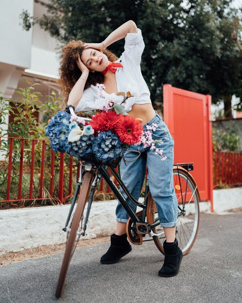Woman In White Top Sitting On Bicycle
