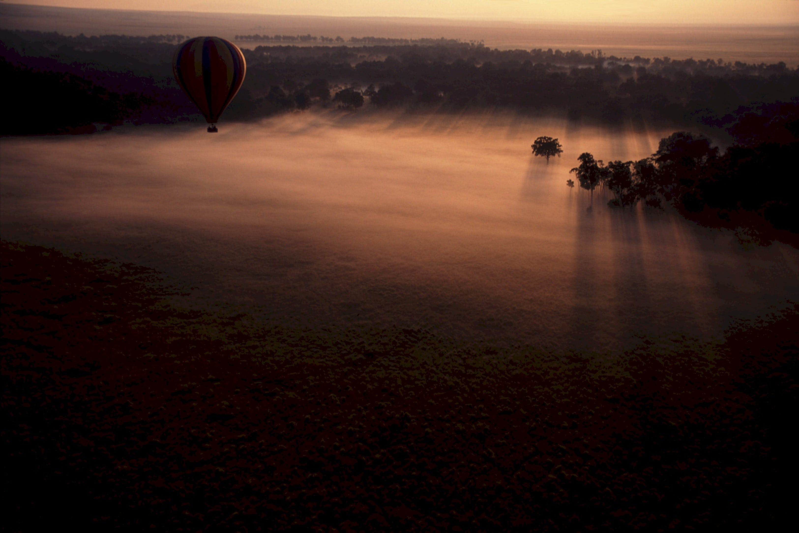 Hot Air Balloon Above Clouds during Sunset