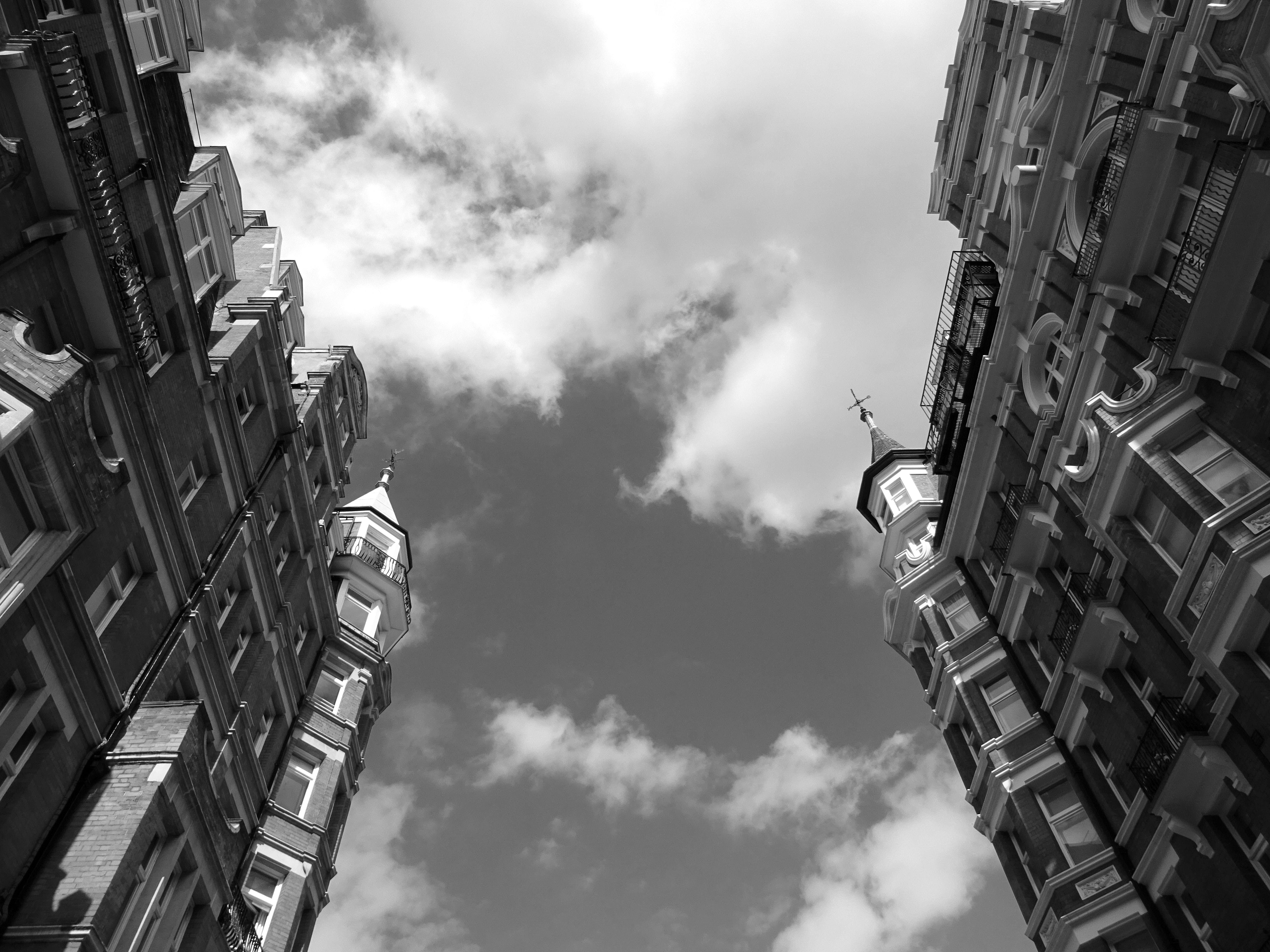 Two Gray High Rise Buildings Under Cloudy Sky
