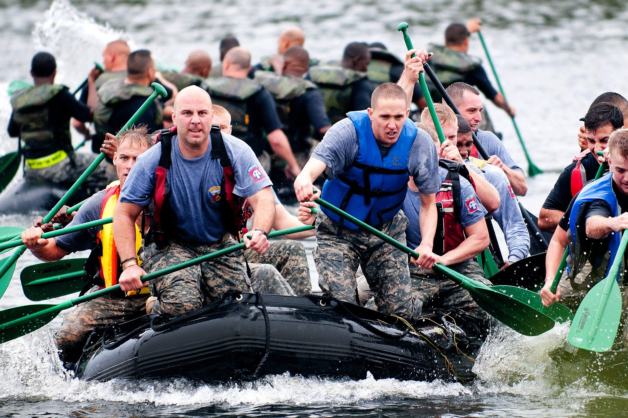 Men Paddling in Inflatable Raft Boat during Daytime